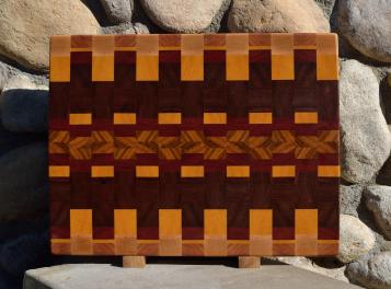 "Cutting Board # 15 - 083. Hard Maple, Cherryt, Yellowheart, Jatoba, Bloodwood & Canarywood. Sold in its first showing. End Grain. 16"" x 20"" x 1-1/2""."