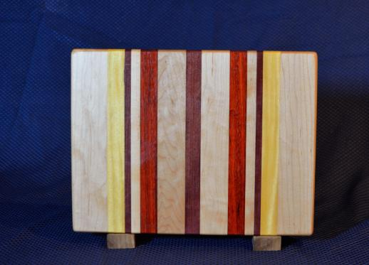 "Cutting Board # 15 - 106. Hard Maple, Yellowheart, Purpleheart & Padauk. Edge Grain. 10"" x 12"" x 1-1/4""."