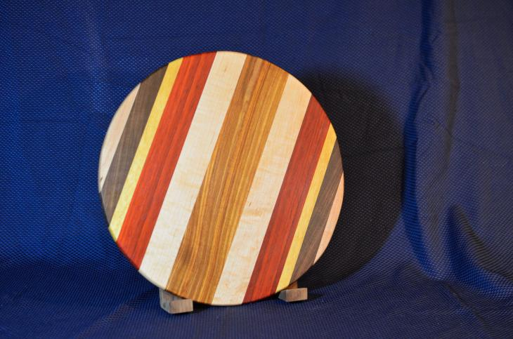 "Lazy Susan # 15 - 031. Hard Maple, Black Walnut, Yellowheart, Padauk and Canarywood. 17"" diameter x 3/4""."