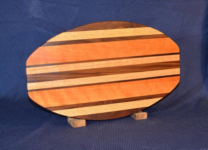 "Surfboard # 15 - 32. Black Walnut, Hard Maple & Cherry. 12"" x 19"" x 1-1/4""."