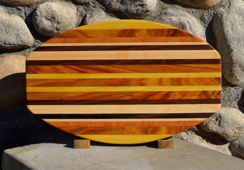 "Surfboard # 15 - 37. Yellowheart, Canarywood, Cherry, Hard Maple & Black Walnut. 12"" x 19"" x 1-1/4""."