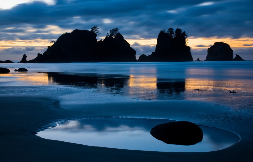 The still tidal pools, rocky islands and lingering sunsets make the beaches of Olympic National Park an explorer's paradise. The salt air, rolling surf and gliding seabirds complete the perfect Pacific Northwest experience. You'll never forget a visit here. Photo of Shi-Shi Beach by John Donofrio. Posted on Tumblr by the US Department of the Interior, 12/4/15.