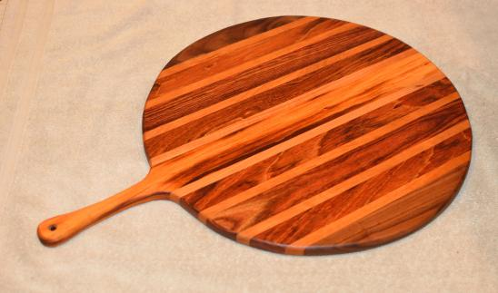"Pizza Server # 15 - 04. Goncalo Alves, Black Walnut, Cherry, Jatoba & Caribbearn Rosewood. 17"" x 3/4"" with 7"" handle."