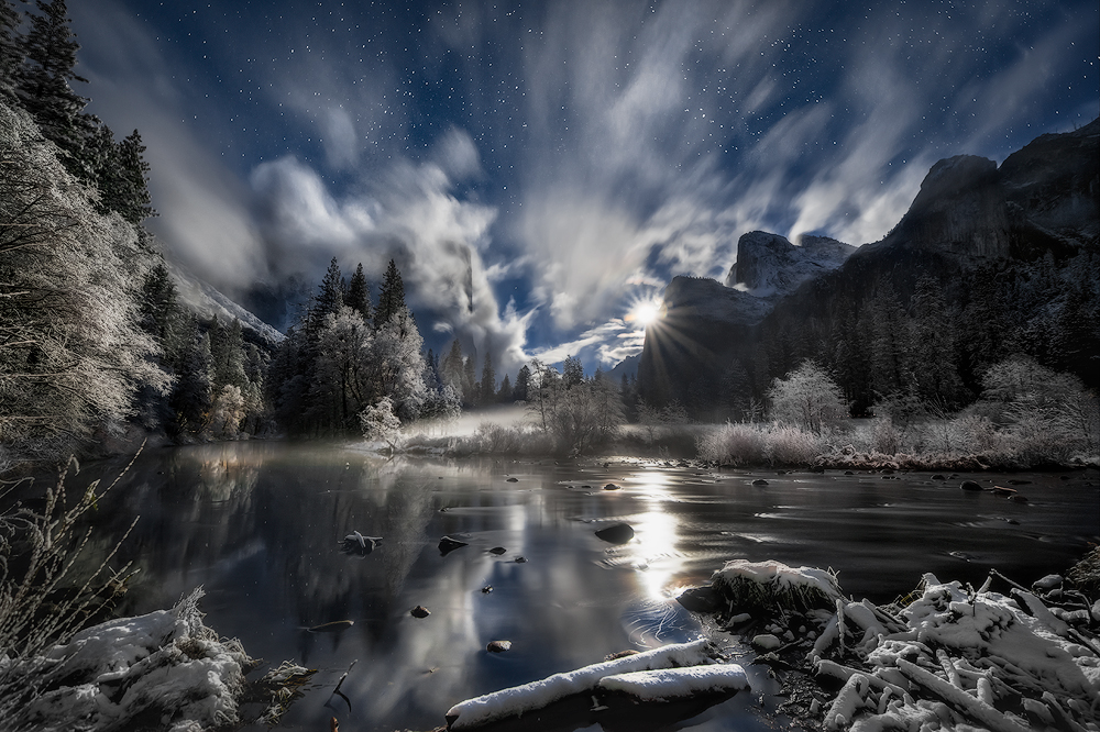 """A magical moonrise over Yosemite National Park in California. Matt Walker captured this night shot – yes, it's a night shot – on Thanksgiving week. It had snowed all day and began clearing around sunset. An hour later, the full moon rose with an intense glow as fog and clouds swirled around Yosemite Valley. """"It was an amazing experience having my 10-year-old son next to me watching this unbelievable moonrise,"""" says Walker. Photo courtesy of Matt Walker. Posted on Tumblr by the US Department of the Interior, 12/18/15."""