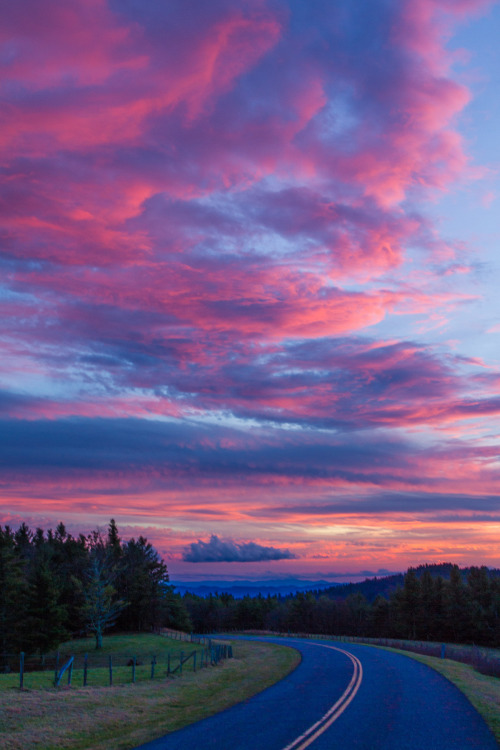 The Blue Ridge Parkway curves over and through gorgeous mountains and valleys. Without a doubt, it is one of the most scenic drives in America. With views like this under cotton candy sunsets, you'll never want to leave. This spectacular moment was captured in the Highlands District of North Carolina. Photo courtesy of Jim Ruff. Posted on Tumblr by the US Department of the Interior, 1/19/16.