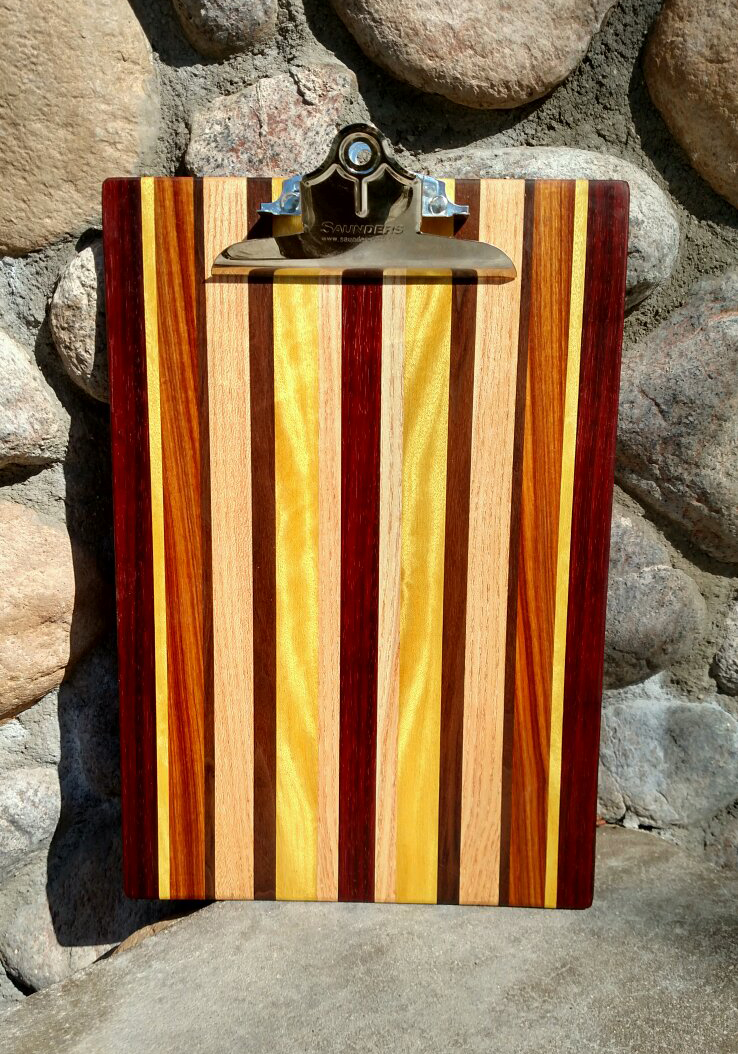Clipboard 16 - 001. Padauk, Honey Locust, Jarrah, Canarywood and Yellowheart. Legal-sized clipboard. Commissioned piece.