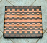 "Cutting Board 16 - End 011. Chaos board. Black Walnut, Padauk, Yellowheart, Cherry, Jatoba, Hard Maple, Bloodwood, Canarywood. End grain. 15"" x 17"" x 1-3/8""."