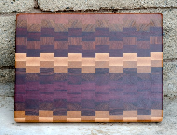 "Cutting Board 16 - End 012. Cherry, Teak, Padauk, Jatoba, Hard Maple, Yellowheart, Canarywood & Purpleheart. End Grain. 11"" x 14"" x 1-1/4""."