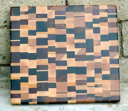 "Cutting Board 16 - end 014. Chaos board. Hard Maple, Black Walnut, Jatoba, Purpleheart, Cherry, Yellowheart, Honey Locust, Padauk & Canarywood. End Grain. 14"" x 15"" x 1-1/4""."