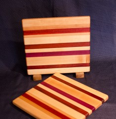"Cheese Board 16 - 007. Edge Grain. Hard Maple, Cherry, Padauk & Purpleheart. 9"" x 11"" x 3/4""."