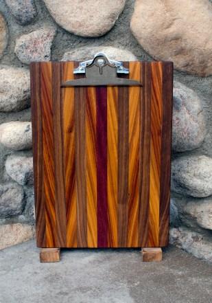 "Clipboard 16 - 002. Black Walnut, Canarywood & Purpleheart. Letter size. 1"" capacity clip."