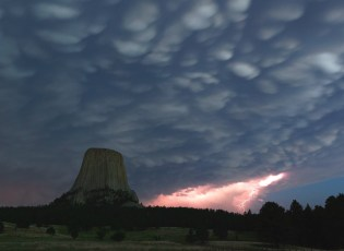 "Sacred to more than a dozen Native American tribes, Devils Tower National Monument in Wyoming was originally called ""Bear's Lodge"" or ""Bear's Tipi."" Its otherworldly appearance played a role in origin stories and the legends of heroes. Rising 600 feet above the surrounding plains, it is an impressive and moving sight. Photo of a lightning strike over the monument by Judit Fabian. Posted on Tumblr by the US Department of the Interior, 4/16/16."