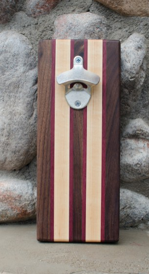 "Magic Bottle Opener 16 - 52. Black Walnut, Purpleheart & Hard Maple. Approximately 5"" x 10"" x 3/4""."