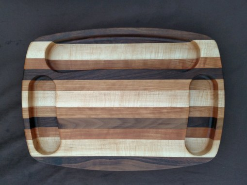 "Cheese & Cracker Server 16 - 02. Maple, Walnut & Cherry. Side reservoirs are 1-1/2"" wide, and the top is 2-1/2"" wide. Piece is 11"" x 15"" x 1-1/2""."
