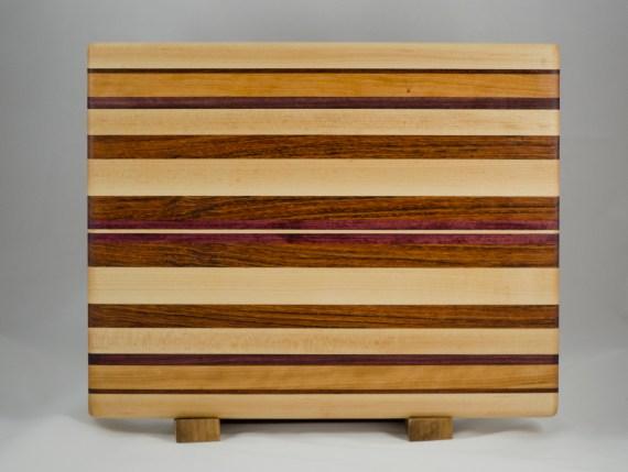 "Cutting Board 16 - Edge 013. Hard Maple, Black Walnut, Cherry, Jatoba & Purpleheart. Edge grain. 14"" x 18"" x 1-1/4""."