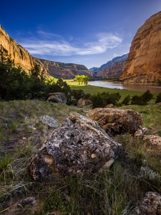 "Dinosaurs once roamed here, and visitors today can see the fossils of these ancient creatures embedded in the rocks of Dinosaur National Monument in Colorado. The park also preserves petroglyphs (patterns chipped or carved into rock) and pictographs (patterns painted on rock) of designs shaped like lizards, birds, spirals and more. Photographer Dustin Baugh captured this beautiful photo before cooking dinner at his campsite: ""The meadow was full of deer and Canadian geese wandering the swollen river banks, with one large bighorn sheep grazing near the cliffs."" Photo courtesy of Dustin Baugh. Posted on Tumblr by the US Department of the Interior, 6/2/16."