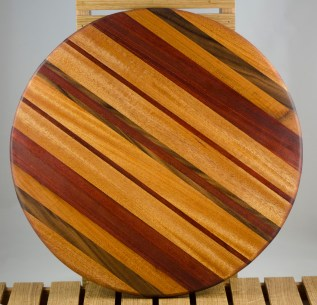 "Lazy Susan 16 - 010. Mahogany, Black Walnut & Bloodwood. 18"" diameter x 3/4""."