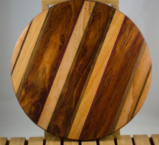 "Lazy Susan # 16 - 010. Mahogany, Jatoba & Black Walnut. 17"" diameter x 3/4""."