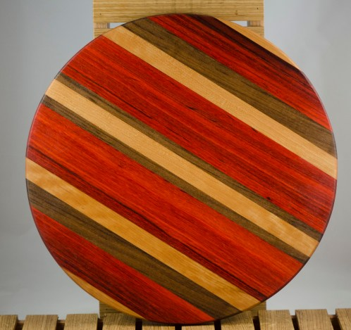 "Lazy Susan 16 - 012. Cherry, Bloodwood, Padauk & Black Walnut. 17"" diameter x 3/4""."