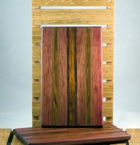 "Cheese Board 16 - 025. Bloodwood, Black Walnut, Jatoba & Caribbean Rosewood. 7"" x 11"" x 3/4""."