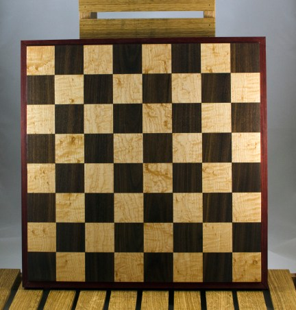 """Chess 16 - 02. Birdseye Maple & Walnut playing surface framed in Padauk. Squares are 2-1/8"""" across."""