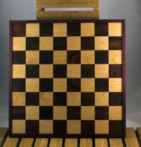 "Chess 16 - 03. Black Walnut & Hard Maple playing surface framed in Purpleheart. Squares are 2-1/8"" across."