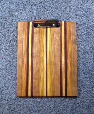 "Clipboard 16 - 013. Cherry, Canarywood, Yellowheart & Purpleheart. 1/2"" clip, letter size."