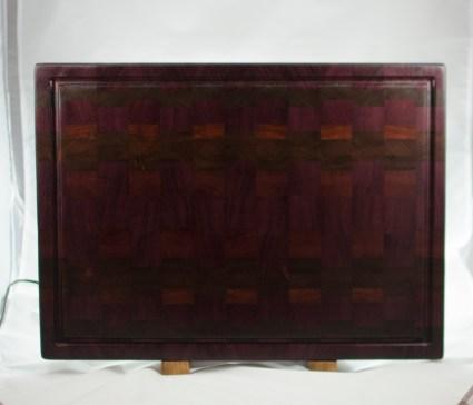 """Cutting Board 16 - End 033. Purpleheart, Black Walnut, Bloodwood & Jatoba. 16"""" x 21-1/2"""" x 1-1/2"""". $375."""