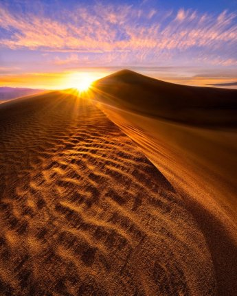 California's Death Valley National Park at sunset. Photo of Mesquite Flat Dunes by Steve Perry. Tweeted by the US Department of the Interior, 5/14/16.