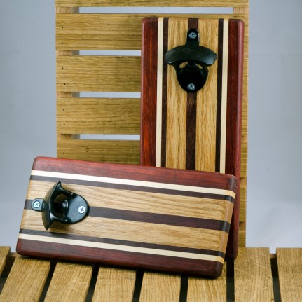 """Magic Bottle Opener 16 - 072. Padauk, Hard Maple, Red Oak & Black Walnut. Double magic, so it will mount to your attractive refrigerator. Approximately 5"""" x 11"""" x 3/4""""."""
