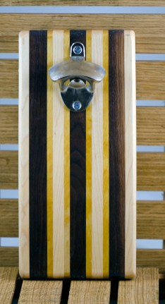 """Magic Bottle Opener 16 - 073. Hard Maple, Black Walnut & Yellowheart. Double magic, so it will mount to your attractive refrigerator. Approximately 5"""" x 11"""" x 3/4""""."""