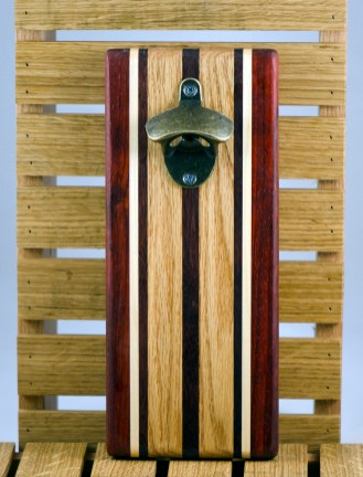 """Magic Bottle Opener 16 - 074. Padauk, Hard Maple, Red Oak & Black Walnut. Double magic, so it will mount to your attractive refrigerator. Approximately 5"""" x 11"""" x 3/4""""."""