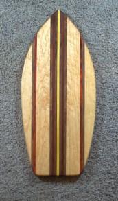 "Medium Surfboard 16 - 08. Padauk, Black Walnut, Yellowheart & Birds Eye Maple. 8"" x 20"" x 3/4""."