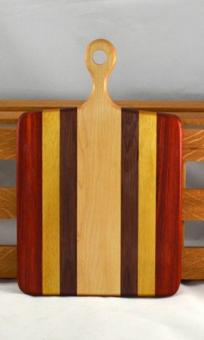 "Sous Chef 16 - 018. Padauk, Yellowheart, Black Walnut & Hard Maple. 9"" x 16"" x 3/4""."