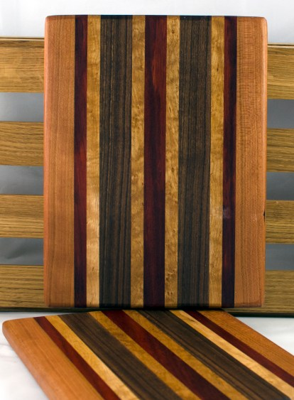 "Cheese Board 16 - 044. Cherry, Bloodwood, Birds Eye Maple & Black Walnut. 9"" x 11"" x 3/4""."