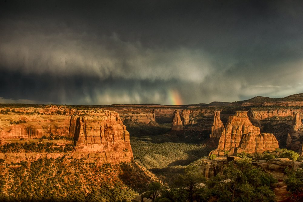A rainbow follows a fleeting storm at Colorado National Monument. Photo by Dawn Morrow. Tweeted by the US Department of the Interior, 8/1/16.