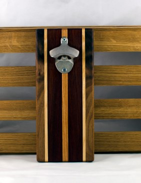 "Magic Bottle Opener 16 - 109. Single Magic. Black Walnut, Hard Maple, Purpleheart & Cherry. 5"" x 10"" x 3/4""."