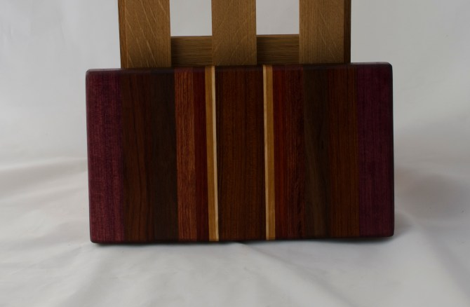 "Small Board 16 - 031. Purpleheart, Jatoba, Bloodwood, Bubinga, Padauk, Cherry & Hard Maple. 12"" x 7"" x 1-1/8""."