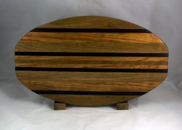 "Cheese & Cracker Server 16 - 17. Hickory, White Oak, Cherry & Black Walnut. 12"" x 19"" x 1-1/4""."
