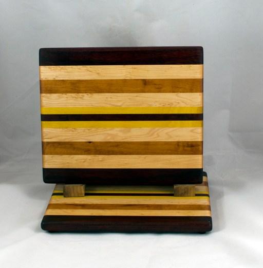 "Cheese Board 16 - 063. Padauk, Hard Maple, Goncalo Alves, Yellowheart & Black Walnut. 8"" x 11"" x 3/4""."