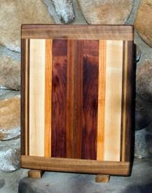 "Cutting Board 17 -106. Black Walnut, Cherry, Hard Maple, Honey Locust, Bubinga & Jatoba. Edge Grain with Bread Board Ends. 12"" x 16"" x 3/4""."