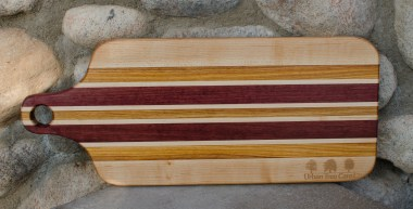 "Engraved 16 - 52. Bread board made for Urban Tree Care. Hard Maple, Canarywood & Purpleheart. 8"" x 20"" x 1""."