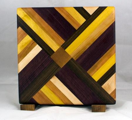 "Cheese Board 17 - 315. Purpleheart, Hard Maple, Cherry, Black Walnut & Yellowheart. Chaos board. 11"" x 11"" x 3/4""."