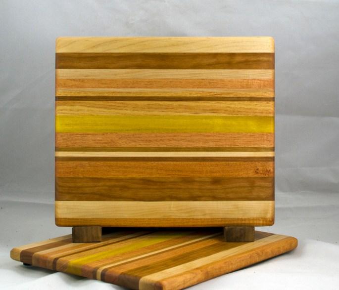 """Cheese Board 17 - 316. Hard Maple, Cherry, Honey Locust & Yellowheart. 10"""" x 11-1/2"""" x 1/2""""."""