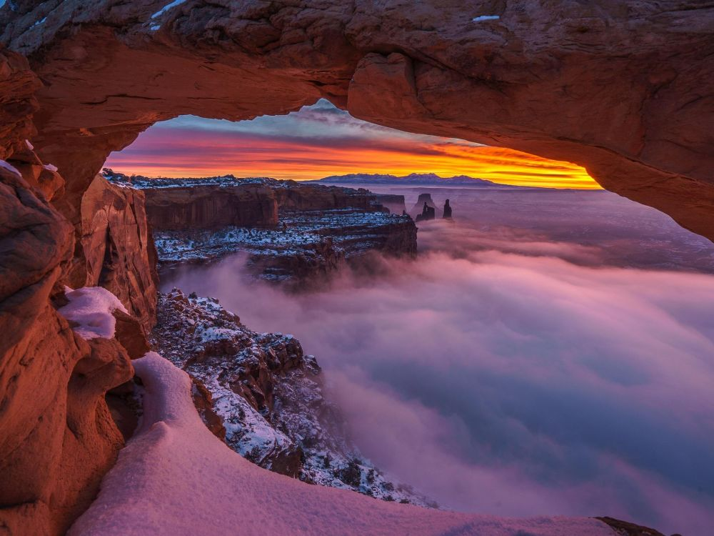 Sunrise, snow and clouds mingle in this spellbinding photo of Canyonlands National Park in Utah.  Photo by Simon Dumont. Posted on Instagram by the US Department of the Interior.