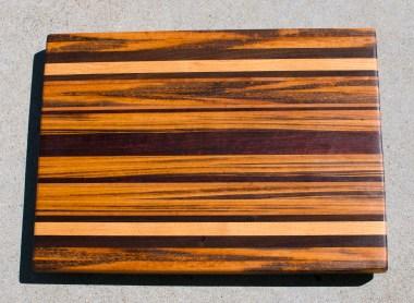 "Cutting Board 17 - 110. Goncalo Alves, Black Walnut, Honey Locust, Cherry & Jarrah. Edge Grain. 17"" x 21"" x 1-1/2""."