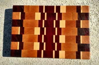 "Cutting Board 17 - 414. Padauk, Cherry, Hard Maple, Bloodwood, Purpleheart, Black Walnut & Jatoba. End Grain. 9-1/2"" x 14"" x 1"". Sold before it was finished."