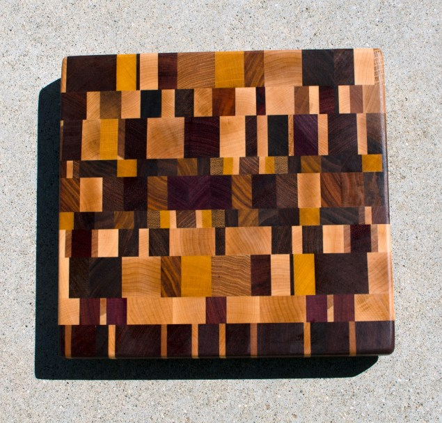 "Cutting Board 17 - 419. Hard Maple, Cherry, Jatoba, Padauk, Yellowheart, Teak, Hickory, White Oak, Purpleheart, Goncalo Alves, Canarywood & Black Walnut. Chaos Board, End Grain. 12"" x 12"" x 1-3/8""."