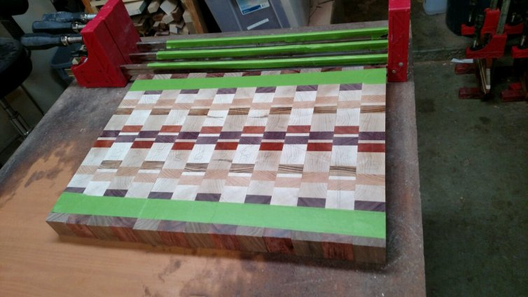 I tape the slices into the right sequence and orientation, and then tape them together until I start the glue session.