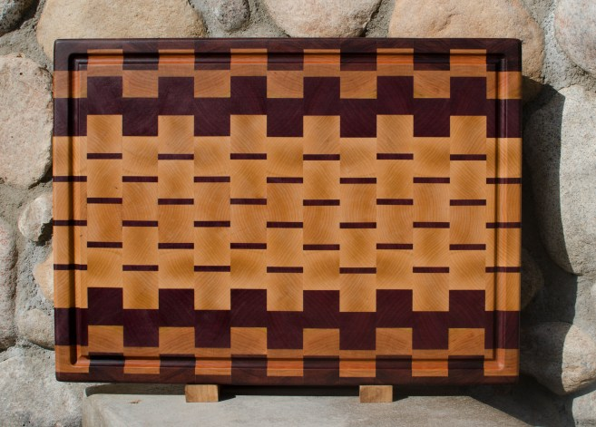 "Cutting Board 17 - 424. Bubinga, Cherry, Purpleheart & Hard Maple. End grain, juice groove. 17"" x 21-1/2"" x 1-1/2""."